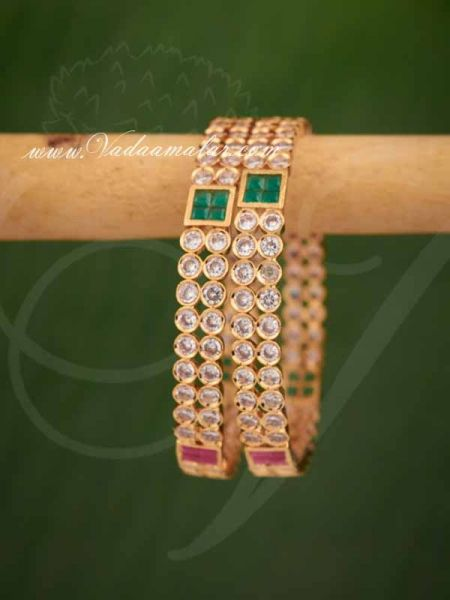 Gold plated white with pink and green stones bangles bracelets - 2 pieces